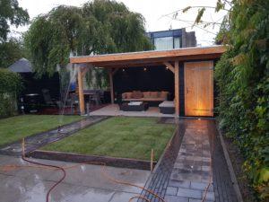 Complete aanleg, Verlichting met In-lite, bestrating, tuinhuis en tuin